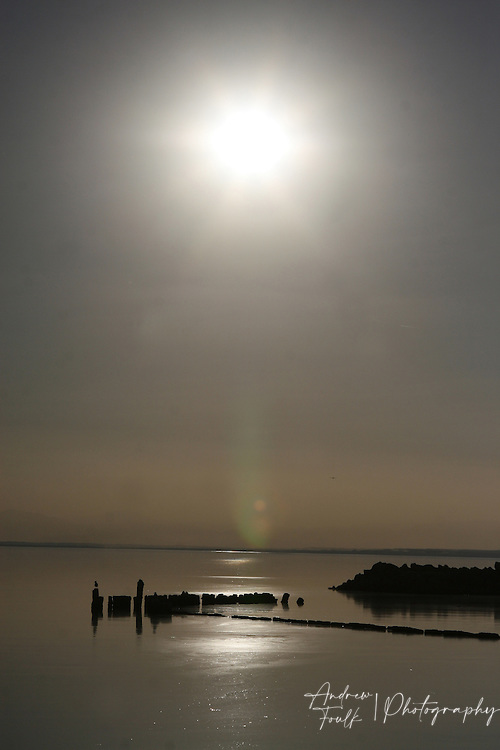 The midday sun looms over the Salton Sea on a very calm day.