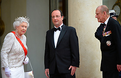 Buckingham Palace has announced Prince Philip, The Duke of Edinburgh, has passed away age 99 - FILE - Preisdent Francois Hollande, Queen Elizabeth II and Prince Philip, Duke of Edinburgh attend the State Banquet given in honour of HM The Queen Elizabeth II by French President Francois Hollande at the Elysee Palace, as part of the official ceremonies of the 70th Anniversary of the D Day, on June 6, 2014, in Paris, France. Photo by Christian Liewig/ABACAPRESS.COM