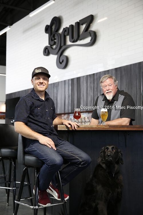 SHOT 7/22/16 1:45:32 PM - Bruz Beers co-founders Charlie Gottenkieny and Ryan Evans inside the new brewery near 67th Avenue and Pecos in Denver, Co. Bruz Beers is Denver's artisanal Belgian-style brewery, featuring a full line of traditional and Belgian-inspired brews, hand-crafted in small batches. Includes images of Evan's dog 'Cooper' as well who serves as the brewery dog. (Photo by Marc Piscotty / © 2016)