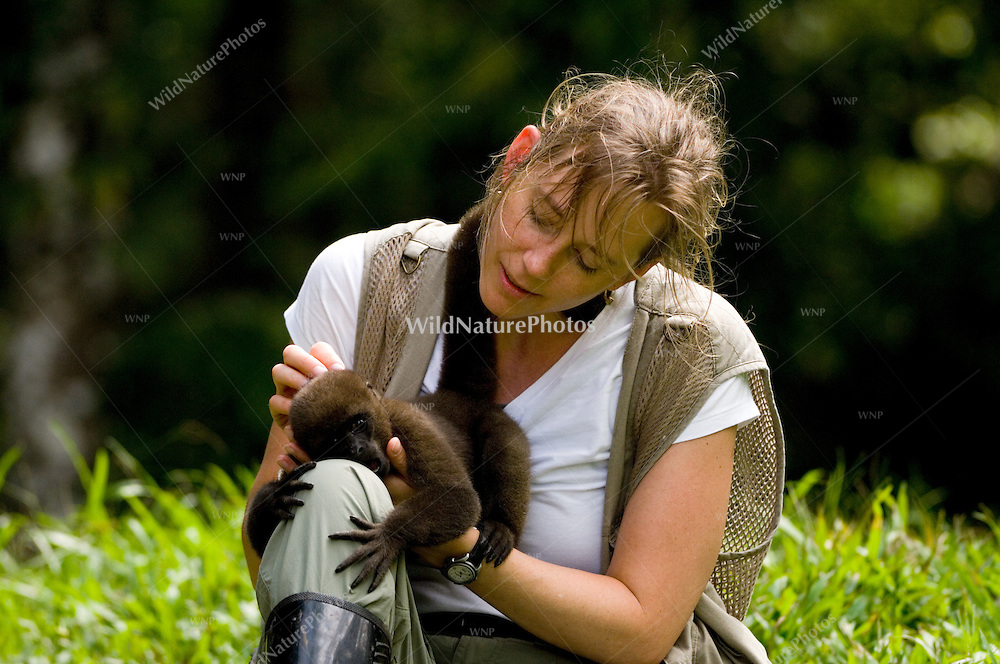 Woman with baby Woolly Monkey in the Napo Rainforest; Ecuador (MR)