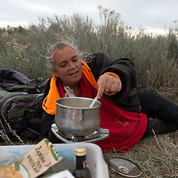 011113      Cayla Nimmo<br /> <br /> Malene Gomes cooks soup for dinner Tuesday evening at her makeshift camp off 265 outside Window Rock.