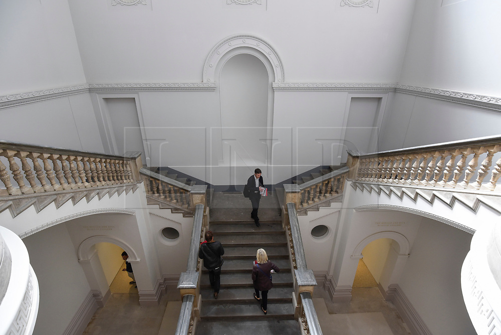 © Licensed to London News Pictures. 14/05/2018. LONDON, UK. General view of the restored staircase at a photocall for the opening of the new Royal Academy of Arts (RA) in Piccadilly.  As part of the celebrations for its 250th anniversary year, redevelopment has seen the RA's two buildings, 6 Burlington Gardens and Burlington House, united into one extended campus and art space extending from Piccadilly to Mayfair.  Photo credit: Stephen Chung/LNP