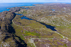 Aerial view of wild landscape and single track road part of North Coast 500 near Clachtoll , Assynt, Scotland UK