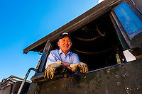 Governor John Hickenlooper (of Colorado) acts as the honorary train engineer on a visit to the the Cumbres & Toltec Scenic Railroad, from Antonito to Osier, Colorado during peak autumn color. The Cumbres & Toltec Scenic Railroad has been jointly owned by the States of Colorado and New Mexico since 1970 when it was purchased from the Denver and Rio Grande Western Railway, which was going to scrap the line.