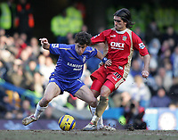 Photo: Lee Earle.<br /> Chelsea v Portsmouth. The Barclays Premiership. 25/02/2006. Chelsea's Joe Cole (L) battles with Pedro Mendes