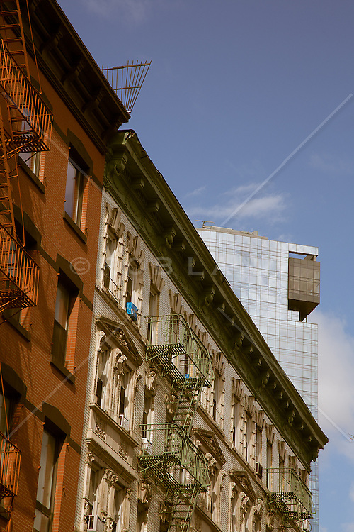 Old New York meets New new York buildings downtown in Soho