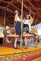 Left to right,  JADE WILLIAMS and ZARA MARTIN at the 2012 Veuve Clicquot Gold Cup Final at Cowdray Park, Midhurst, West Sussex on 15th July 2012.