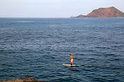 Man board paddling in sea at Corralejo, Fuerteventura, Canary Islands, Spain