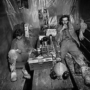 Tram crew Dave Effenberger and Claude ?Shaggy? Ludgate having lunch on the1300 foot level, Kerr Mine, Virginiatown, Ontario. From the book Cage Call: Life and Death in the Hard Rock Mining Belt. An in-depth project spanning over 12-years examining communities in one of the richest mining regions in the world located in Northwestern Ontario and Northeastern Quebec in Canada.