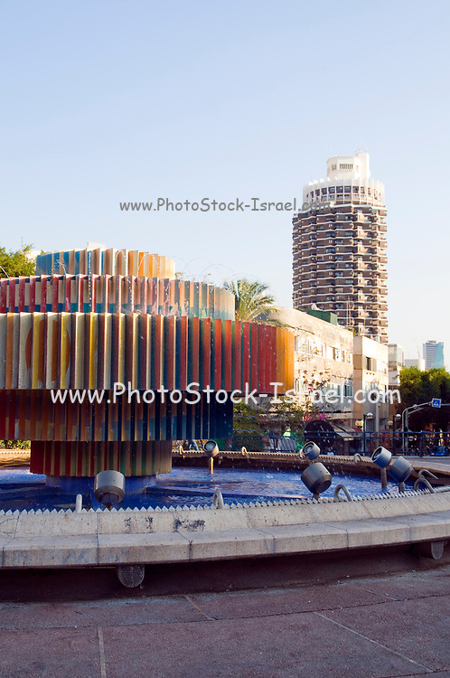Israel, Tel Aviv The Kinetic fire and water fountain by Yaacov Agam at Dizengoff square. Dizengoff tower in the background