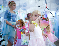 A magical evening for Kelsey Burgess as she talks to the fairies through music   during Cackleberries 5th annual Fairy Night in the Garden on Friday evening.  (Karen Bobotas/for the Laconia Daily Sun)