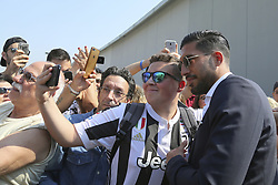 June 21, 2018 - Turin, Piedmont, Italy - New Juventus signing Emre Can poses for a selfie with his fan Efollowing his arrival in Turin on June 21, 2018 in Turin, Italy. (Credit Image: © Massimiliano Ferraro/NurPhoto via ZUMA Press)