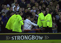 Photo: Greig Cowie<br />Barclaycard Premiership. Leeds United v West Ham United. 08/02/2002<br />Eirik Bakke is taken from the field with an injury