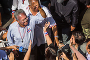 21 JANUARY 2014 - BANGKOK, THAILAND: SUTHEP THAUGSUBAN, greets supporters during a march down Thanon Naradhiwas Rajanagarindra in the financial district of Bangkok. Suthep, the leader of the anti-government protests and the People's Democratic Reform Committee (PDRC), the umbrella organization of the protests, led a march through the financial district of Bangkok Tuesday. Shutdown Bangkok has entered its second week with no resolution in sight. Suthep is still demanding the caretaker government of Prime Minister Yingluck Shinawatra resign and the PM says she won't resign and intends to go ahead with the election.     PHOTO BY JACK KURTZ