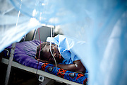 Seybatu Koroma, 32, lies on a bed in the maternity ward as she recovers after a procedure to remove the placenta from her womb at the UBC hospital in Mattru Jong, Sierra Leone, on Tuesday April 20, 2010. Seybatu suffered from a retained placenta after losing her child while giving birth in her village, 15 miles away. This was her eighth delivery - she has three living children..