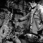 """Offerings to the """"tio"""": an anthropomorphic figure which represents the devil, lord and master of the mine, for whom the miners have an unwavering devotion. Cerro Rico of Potosí. Bolivia."""