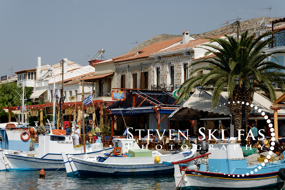 Samos. Greece. The Pythagoreio waterfront bursting with restaurants, cafes and colourful fishing boats docked in its harbour. The town of Pythagoreio is the most popular and fashionable town on the island and was named after the great philosopher Pythaogaras who was born here in 580 BC.