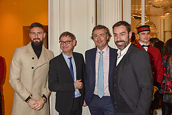 Left to right, Olivier Giroud, Cyrille Vigneron, Laurent Feniou, Robert Pires  at the reopening of the Cartier Boutique, New Bond Street, London, England. 31 January 2019. <br /> <br /> ***For fees please contact us prior to publication***