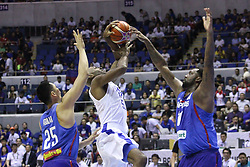 November 27, 2017 - Quezon City, NCR, Philippines - Quincy Davis (50) of Chinese Taipei tries to shoot the ball over Andray Blatche (11) and Japeth Aguilar (25) of the Philippines during their FIBA World Cup Qualifiers Match..Gilas Pilipinas defeated the visiting Chinese Taipei team 90-83 to complete a sweep of their first two assignments in the FIBA 2019 World Cup qualifiers. (Credit Image: © Dennis Jerome S. Acosta/Pacific Press via ZUMA Wire)