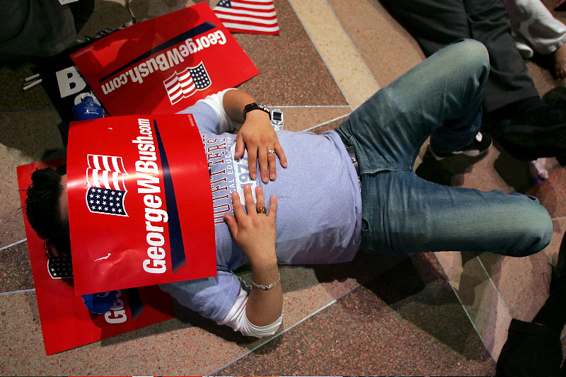 A George Bush campaign worker sleeps on the floor at the Reagan International Trade Building in Washington D.C. on election night at about 4 am after waiting for George Bush to make an appearance before the crowd.  Bush did not appear until 3 pm the next afternoon.