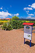 Interpretive sign and coffee trees at the Kauai Coffee Company, Island of Kauai, Hawaii