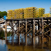 Commercial lobster traps stacked dockside in New Harbor Maine, June 2013.
