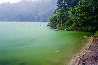 Indonesia, Sulawesi, Linow. Linow Lake is a volcanic crater, with hot springs lining the crater walls. The changing mix of chemicals in the gases causes the lake to change colors, from red to deep green to blue.