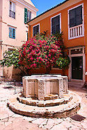 1690 Venetian well of Antonio Cocchini.  Campiello area of Corfu Old Town, Greek Ionian Islands .<br /> <br /> If you prefer to buy from our ALAMY PHOTO LIBRARY  Collection visit : https://www.alamy.com/portfolio/paul-williams-funkystock/corfugreece.html <br /> <br /> Visit our GREECE PHOTO COLLECTIONS for more photos to download or buy as wall art prints https://funkystock.photoshelter.com/gallery-collection/Pictures-Images-of-Greece-Photos-of-Greek-Historic-Landmark-Sites/C0000w6e8OkknEb8