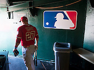 The Angels' Mike Trout heads to the field before the Halos' game against the Athletics Sunday in Oakland.