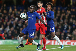 5 December 2017 - Champions League Football - Chelsea v Atletico Madrid - Victor Moses of Chelsea, Yannick Carrasco of Atletico Madrid and Willian of Chelsea battle for the ball - Photo: Charlotte Wilson / Offside