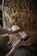 Traditional log carving in Thailand