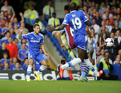 "Chelsea's Eden Hazard scores past Aston Villa's Brad Guzan  - Photo mandatory by-line: Joe Meredith/JMP - Tel: Mobile: 07966 386802 21/08/2013 - SPORT - FOOTBALL - Stamford Bridge - London - Chelsea V Aston Villa - Barclays Premier League - EDITORIAL USE ONLY. No use with unauthorised audio, video, data, fixture lists, club/league logos or ""live"" services. Online in-match use limited to 45 images, no video emulation. No use in betting, games or single club/league/player publications"