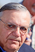 """04 FEBRUARY 2009 -- County Sheriff Joe Arpaio talks to reporters and tells them he does not to be compared to Hitler, as several prisoners did when they were marched into Tent City. Maricopa County Sheriff Joe Arpaio marched about 200 undocumented immigrants in the Durango Jail to """"Tent City"""" where he will house the prisoners until or if they are deported. PHOTO BY JACK KURTZ"""