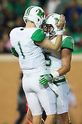 Marshall Thundering Herd quarterback Chase Litton (1) celebrates with tight end Ryan Yurachek (85) after the two connected for a 1-yard-touchdown against the North Texas Mean Green during the 2nd half at Apogee Stadium in Denton, Texas on October 8, 2016. (Cooper Neill for The Herald-Dispatch)