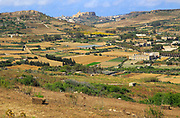 Rural farming landscape view to citadel castle at Victoria Rabat, from near Xaghra island of Gozo, Malta