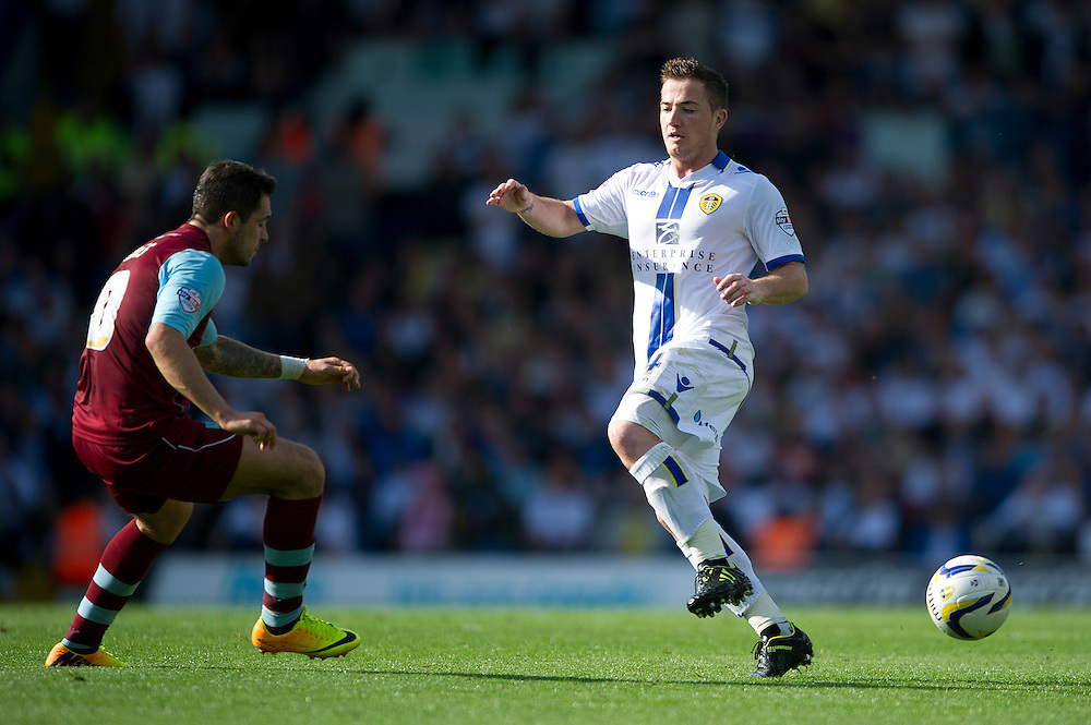 Leeds United's Ross McCormack and Burnley's Dean Marney<br /> <br /> Photo by Stephen White/CameraSport<br /> <br /> Football - The Football League Sky Bet Championship - Leeds United v Burnley - Saturday 21st September 2013 - Elland Road - Leeds<br /> <br /> © CameraSport - 43 Linden Ave. Countesthorpe. Leicester. England. LE8 5PG - Tel: +44 (0) 116 277 4147 - admin@camerasport.com - www.camerasport.com