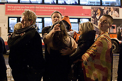 "© under license to London News Pictures. 18/12/2010 as snow blizzards hit Manchester revellers continue their ""Mad Friday"" night out. Long taxi queues following traffic delays forced couples to huddle together for warmth"