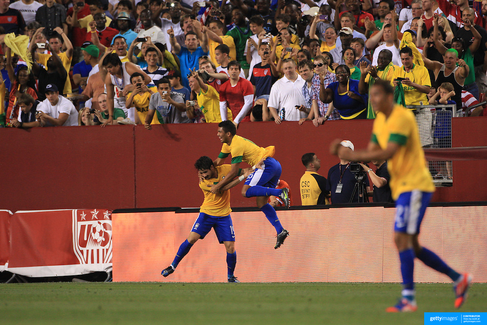 Alexandre Pato, Brazil, (left)  is congratulated by team mate Casemiro after scoring during the USA V Brazil International friendly soccer match at FedEx Field, Washington DC, USA. 30th May 2012. Photo Tim Clayton