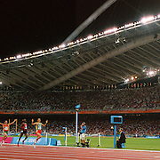 A panoramic image of Hicham El Guerrouj of Morocco celebrates winning Gold in the men's ,500 m final during the Athens 2004 Summer Olympic Games at the Olympic Stadium, Greece on 24th August, 2004. Photo Tim Clayton
