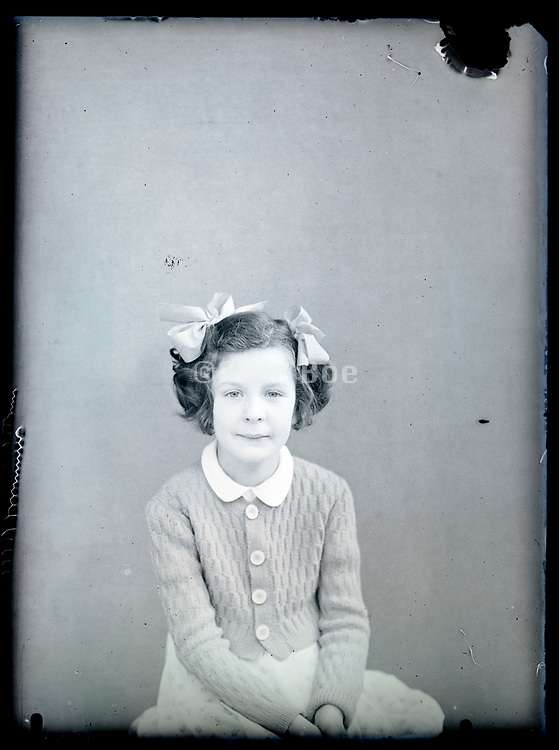 vintage studio portrait of young female person looking at the camera, circa 1930s