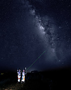 Where do we come from?  People from the Samburu tribe (Kenya) points and look at the Milky Way from the local savannah.