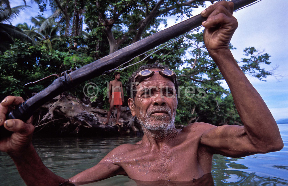 AGTAS (Aboriginal natives, related to  pigmies) hunt fish with home made harpoons and coconut carved goggles in Gumacas bay, Aurora, Philippines