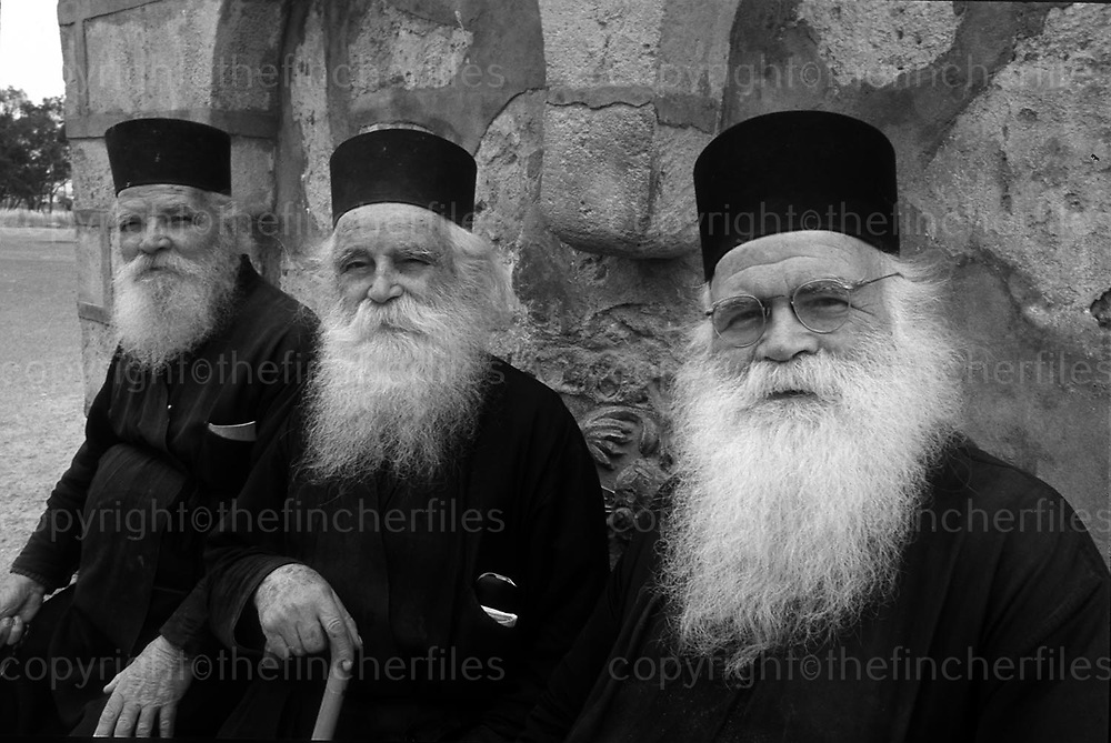 Three Greek Orthodox brothers seen in Nicosia, Cyprus. Photographed by terry Fincher
