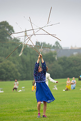 Edinburgh, Scotland, UK. 22nd August 2021. Outdoor dance performance held in Holyrood Park as part of the Edinburgh International Festival. Field -  Something for the Future Now is directed by Christine Devaney and features an ensemble of Edinburgh-based performers, Field is an immersive, uplifting work and performers respond to the surrounding landscape and each other by following a series of movement and live sound scores.that has Arthur's Seat as its backdrop. Iain Masterton/Alamy Live News.