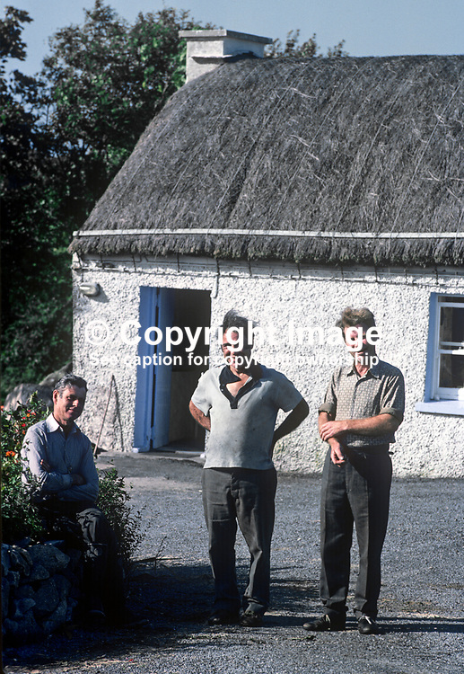 """Home weavers outside their """"factory"""" in Ardara, Co Donegal, Rep of Ireland. 197809000246d.<br /> <br /> Copyright Image from Victor Patterson, Belfast, UK<br /> <br /> t: +44 28 9066 1296 (from Rep of Ireland 048 9066 1296)<br /> m: +44 7802 353836<br /> e: victorpattersonbelfast@gmail.com<br /> <br /> www.images4media.com<br /> <br /> Please see my full Terms and Conditions of Use at https://www.images4media.com/p/terms-conditions - it is IMPORTANT that you familiarise yourself with them.<br /> <br /> Images used online incur an additional cost. This cost should be agreed in writing in advance. Online images must be visibly watermarked i.e. © Victor Patterson or that of the named photographer within the body of the image. The original metadata must not be deleted from images used online.<br /> <br /> This image is only available for the use of the download recipient i.e. television station, newspaper, magazine, book publisher, etc, and must not be passed on to a third party. It is also downloaded on condition that each and every usage is notified within 7 days to victorpattersonbelfast@gmail.com.<br /> <br /> The right of Victor Patterson (or the named photographer) to be identified as the author is asserted in accordance with The Copyright Designs And Patents Act (1988). All moral rights are asserted."""