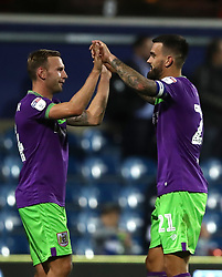 Bristol City's Andreas Weimann celebrates with his captain Marlon Pack (right) at the end of the Sky Bet Championship match at Loftus Road, London.
