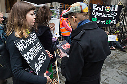London, UK. 10 June, 2019. Members of the public converse with activists from BP or not BP? disrupting the BP Portrait Award with a 'creative blockade' against oil sponsorship. The activists linked arms to block all entrances to the National Portrait Gallery, forcing guests to the awards to clamber over railings at the rear entrance to gain access, as well as creating live portraits outside the gallery of activists from West Papua, Mexico, Samoa and the US Gulf Coast fighting back against BP's pollution and climate devastation around the world. Energy company BP has sponsored the NPG's award for 30 years, but its high-profile involvement is attracting growing criticism for environmental reasons. A judge of this year's award, leading artist Gary Hume, has publicly called for the gallery to end its relationship with BP, as have eight former exhibitors including two former award winners Wim Heldens and Craig Wiley. Credit: Mark Kerrison/BP or not BP?