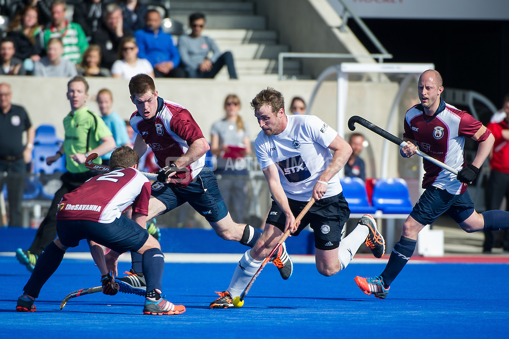 East Grinstead's Chris Griffiths tries to go round Michael Hoare of Wimbledon. East Grinstead v Wimbledon -  Now: Pensions Men's Hockey League Championship Final, Lee Valley Hockey & Tennis Centre, London, UK on 12 April 2015. Photo: Simon Parker