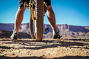 SHOT 10/16/16 3:45:26 PM - Taking in the view along the White Rim Trail. The White Rim is a mountain biking trip in Canyonlands National Park just outside of Moab, Utah. The White Rim Road is a 71.2-mile-long unpaved four-wheel drive road that traverses the top of the White Rim Sandstone formation below the Island in the Sky mesa of Canyonlands National Park in southern Utah in the United States. The road was constructed in the 1950s by the Atomic Energy Commission to provide access for individual prospectors intent on mining uranium deposits for use in nuclear weapons production during the Cold War. Four-wheel drive vehicles and mountain bikes are the most common modes of transport though horseback riding and hiking are also permitted.<br /> (Photo by Marc Piscotty / © 2016)