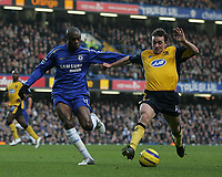 Photo: Lee Earle.<br /> Chelsea v Wigan Athletic. The Barclays Premiership.<br /> 10/12/2005. Chelsea's William Gallas tracks Wigan's David Connolly.